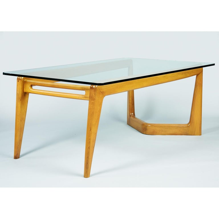 Pierluigi Giordani, attr. (1924 - 2011)   An exceptional, sculptural, and monumental biomorphic dining table in polished walnut attributed to pioneering Italian midcentury designer Pierluigi Giordani, the sought-after contemporary of Gio Ponti and