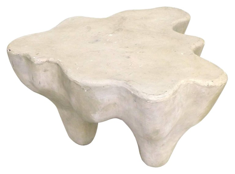 A wonderful and unusual biomorphic side table in gesso-over-resin. Very much in the style of, and possibly by Les Simonnets, a fantastic and dynamic, percolating piece with a winding, protruding perimeter who's curves continue, jutting down through
