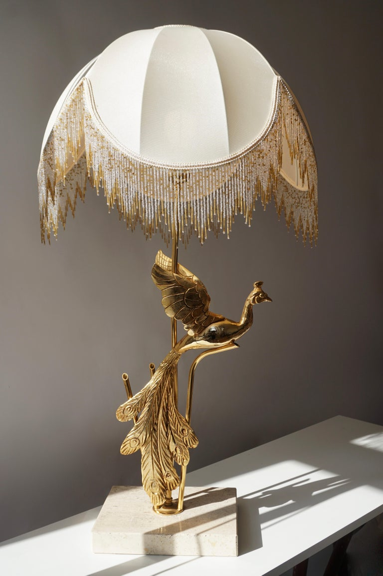 A truly eye-catching, unusual gilt metal table or floor lamp, fashioned in the shape of a Peacock. Designed in the style of Maison Jansen and produced circa 1970s in Italy. The Peacock has a beautiful original Patina and the lamp is in good