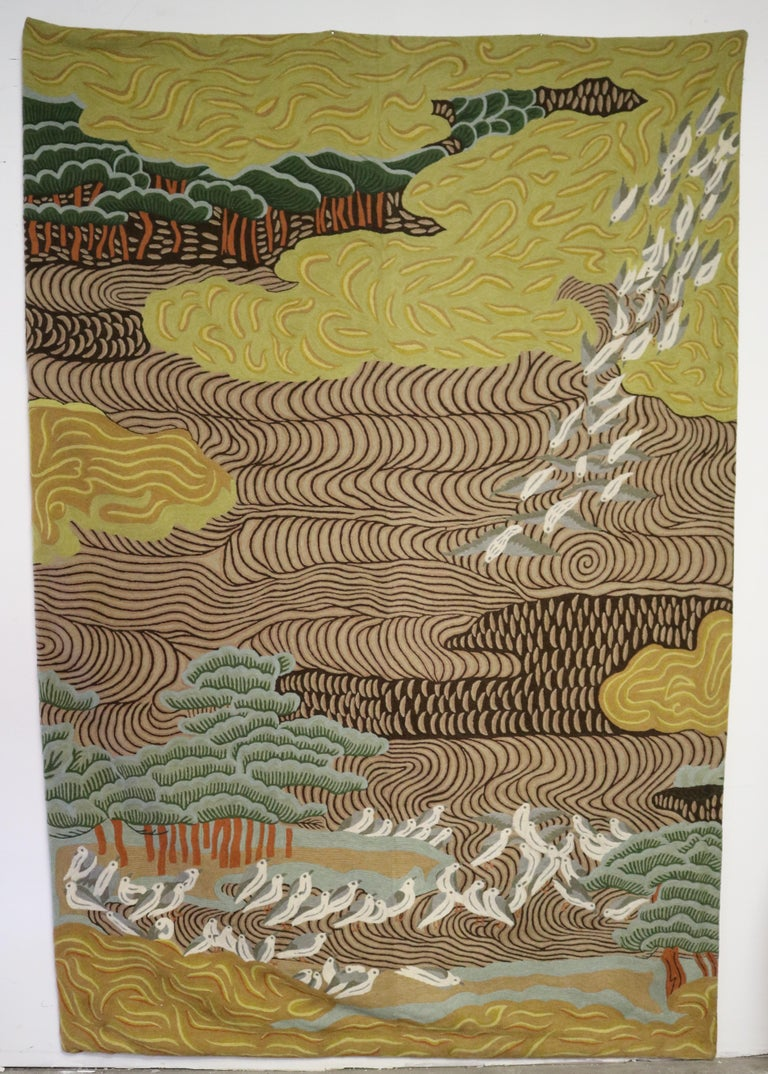 The embroidery depicts a dream woods landscape with flocks of birds. It's made of wool and tacked between 2 wood rods.