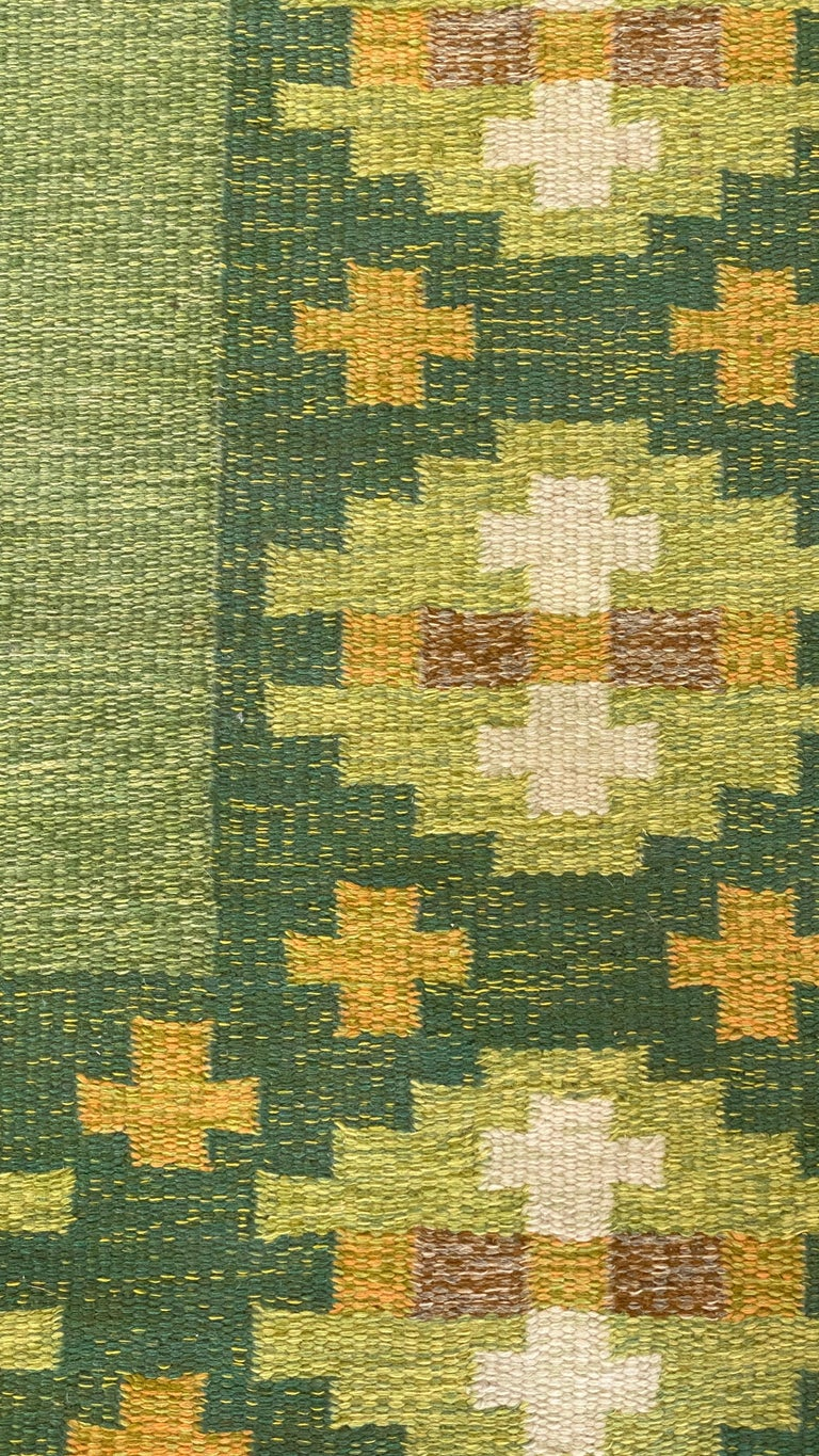 A handwoven modernist flat-weave carpet / rug by Birgitta Södergren. Most likely woven in the 1950s. Handwoven in wool, using a Kilim technique. Signed  Follows a lineage of modernist rugs produced in Sweden throughout the 20th century. Other