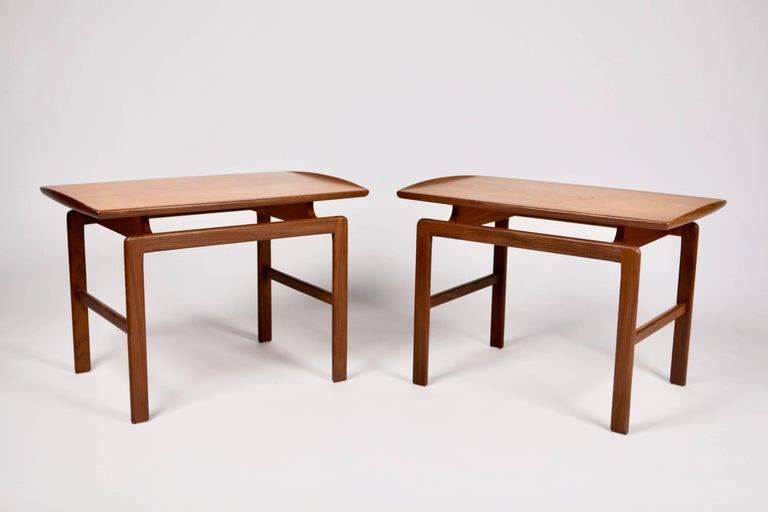 A pair of teak side tables, model