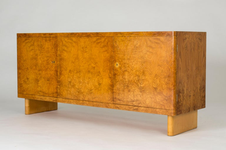 """Stunning birch root sideboard by Axel Einar Hjort, model named """"Birka"""". Exceptionally cool, elegant and timeless design with a certain lightness notwithstanding the solid expression. Beautiful root veneer in very good condition, with some smaller"""