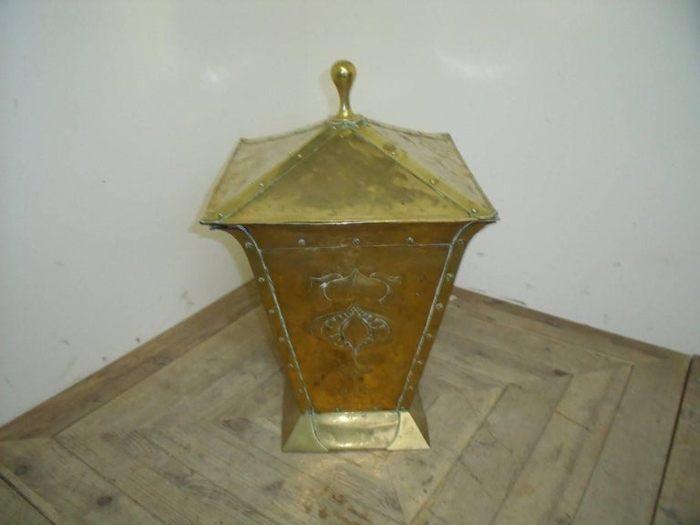 A Birmingham Guild of Handicraft, Arts & Crafts brass coal bucket with stylized hand formed pomegranates.  Retaining the original liner.  The Birmingham Guild of Handicraft was established in 1890 by local admirers of William Morris and John