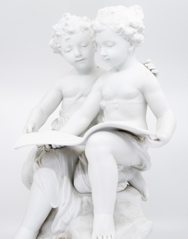 A 19th century French bisque sculpture of a stature of boy and girl reading a book.  Biscuit porcelain with indistinct signature to base 'LIARD',   Shipping included  Free and fast delivery door to door by air Original art work(s) from