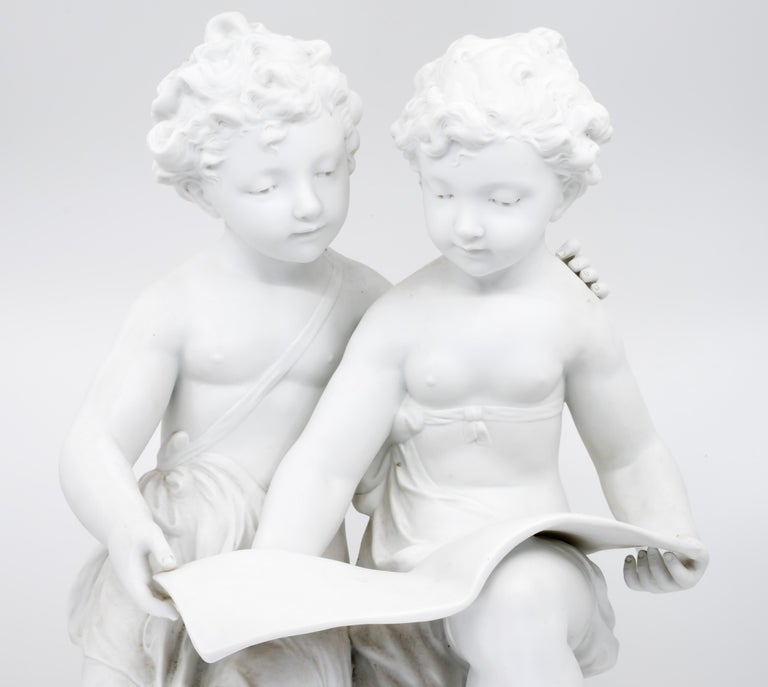 Hand-Carved Bisque Porcelain a Stature of Boy and Girl Reading a Book, French, 19th Century For Sale