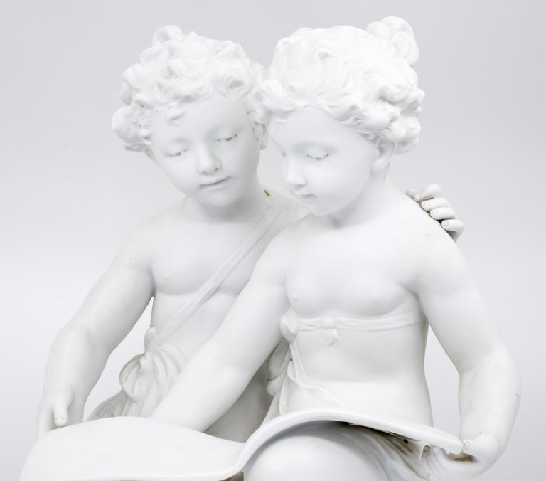 Carrara Marble Bisque Porcelain a Stature of Boy and Girl Reading a Book, French, 19th Century For Sale