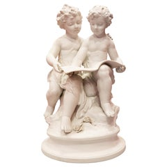 Bisque Porcelain a Stature of Boy and Girl Reading a Book, French, 19th Century