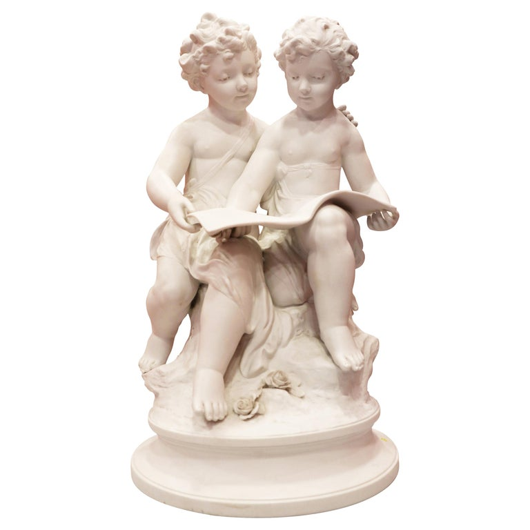 Bisque Porcelain a Stature of Boy and Girl Reading a Book, French, 19th Century For Sale
