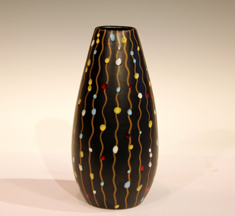 Early V mark 1950s Bitossi vase decorated with hanging party lights on a black ground, circa 1950s. 8 1/2