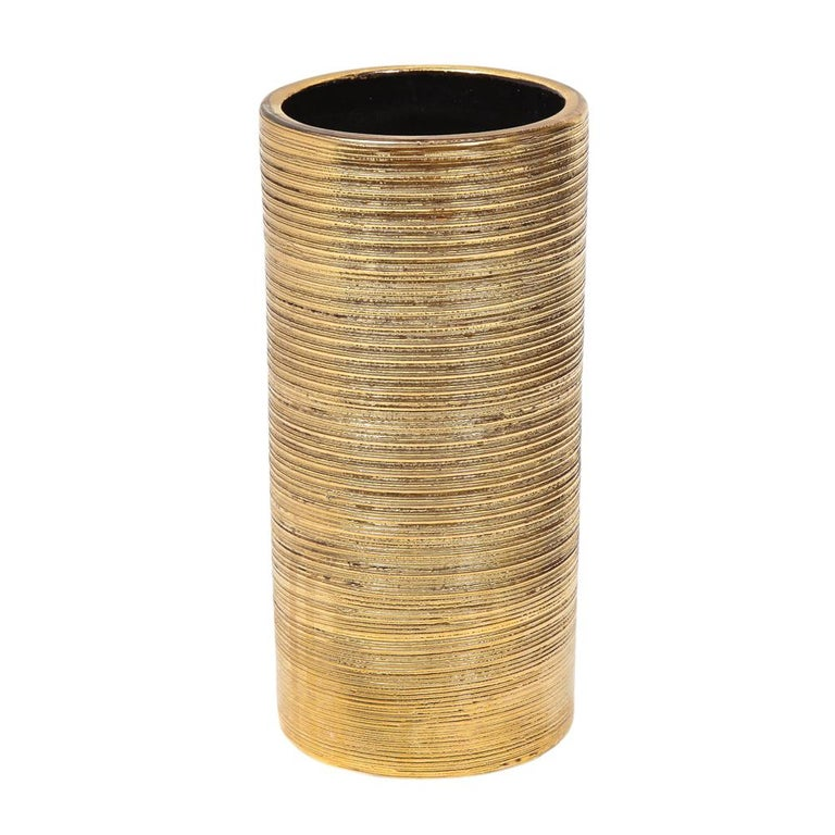 Bitossi vase, ceramic, brushed gold. Small to medium scale cylinder vase with textured brushed gold glaze. The Bitossi factory mixed 24-karat gold to achieve the luster to their gold glazes.The underside retains the original paper import label;