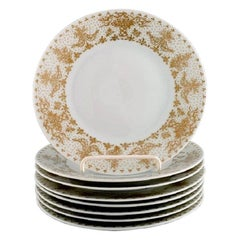 Bjørn Wiinblad for Rosenthal, Eight Plates in Porcelain with Gold Decoration