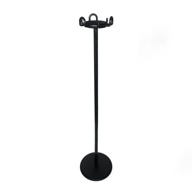 A classic and always fashionable black Aiuto coat stand designed by Raul Barberi and Giorgio Marianelli for Rexite in 1982 as the company's first coat rack. Black steel base, black polymer coated metal stem, with multiple polymer coated metal hooks