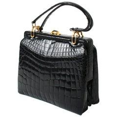 Black Alligator Handbag with Gold Tone Link Hardware
