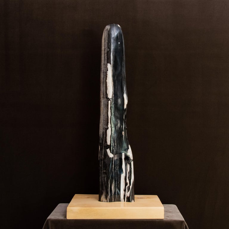 This piece of peerless beauty is a perfect example with proportions and appear that make any interior unique. The predominant color is a gradation of black with white veins. The natural wood base was specially made to hold the mineral. Not only