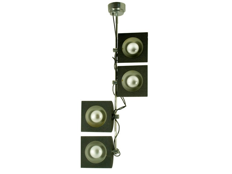 This Italian four-light pendant was produced by BJ Milano design in the 1970s. It features four adjustable lampshades that can rotate and run along the chrome-plated rod. Each lampshade shows the