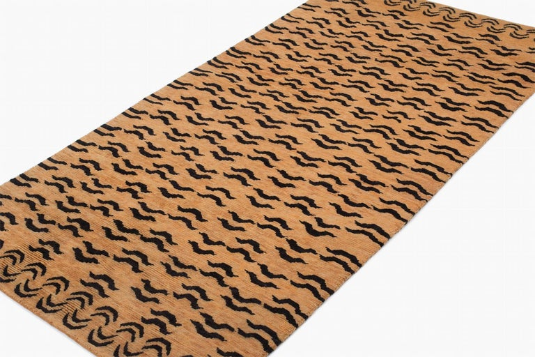 This rug is woven in a special weaving project in a women's coop using special lost weaving techniques. We use secret knotting techniques to make special effects.   The rug is woven in all natural botanical dyes and is extremely authentic. The