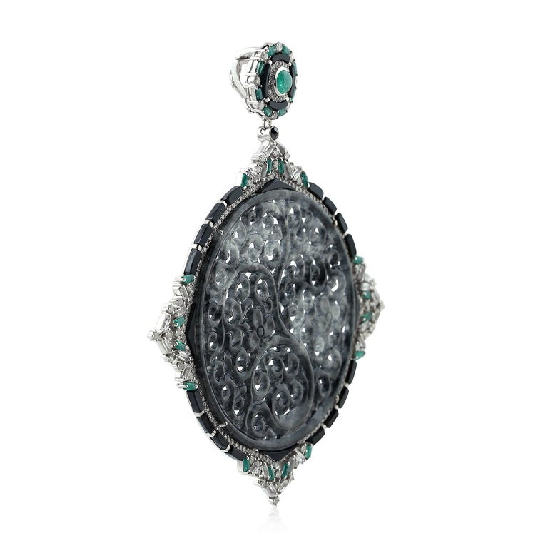 One of a kind beautiful black and grey carved Jade pendant with round and baguette diamonds and emeralds set in 18K white gold and silver is a lovely and bold pendant and can be paired with any long chain you have as the bayle at the back is