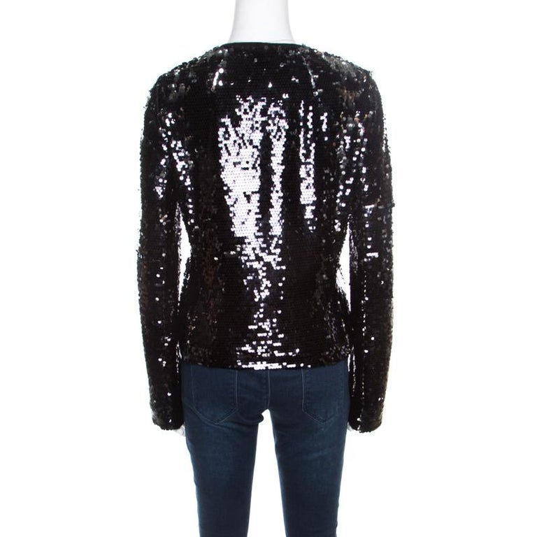 A perfect piece of party clothing for fashion lovers, this Dolce & Gabbana jacket is sure to stand out and make a statement. Constructed in black sequin paillette embellished fabric, this jacket is sure to make even the simplest of looks ready for
