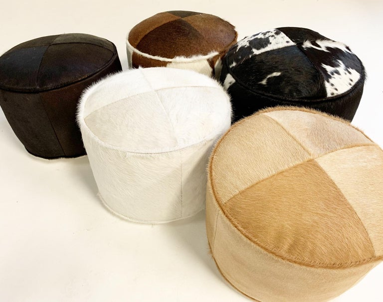 Our luxurious cowhide pouf ottomans are handcrafted from our beautiful Forsyth Brazilian cowhides. The most beautiful cowhides are selected handcut, hand stitched and hand stuffed. Down feathers fill each pouf, 12 pounds to be exact and each is