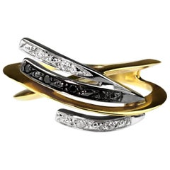 Black and White Diamond Knife Edge Twist Ring in 18 Karat White and Yellow Gold