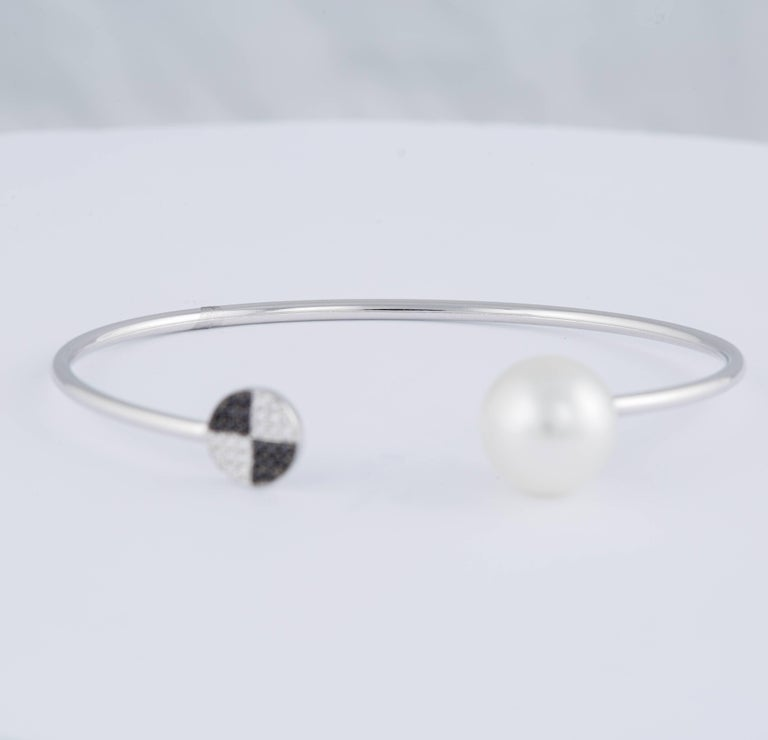 Contemporary Black and White Diamond South Sea Pearl Bangle 0.12 Carat 18 Karat White Gold For Sale