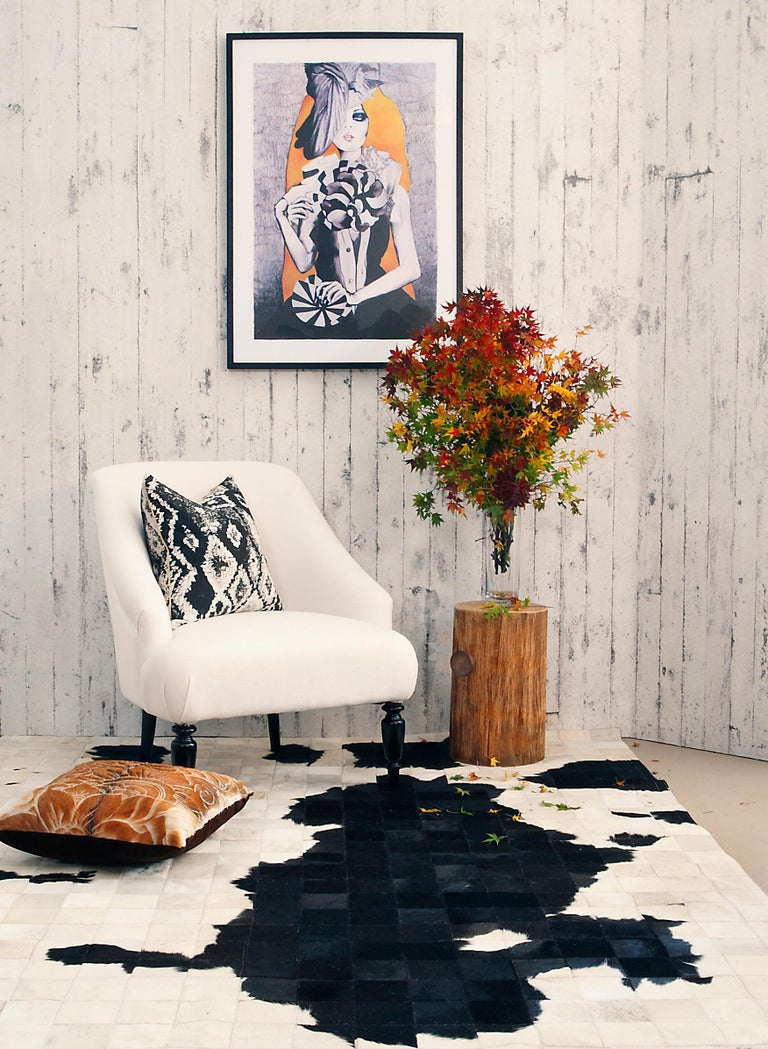 """Fun, new Minimalist Scandi inspired rug, the Dalmata, features black and white Argentinian cowhide tiled into a Dalmatian style pattern. Small measures 2 x 14.m (4'6"""" x 5'9""""). Large measures 2 x 3M (6'7"""" x 9'8"""").  Art Hide rugs are usually made to"""