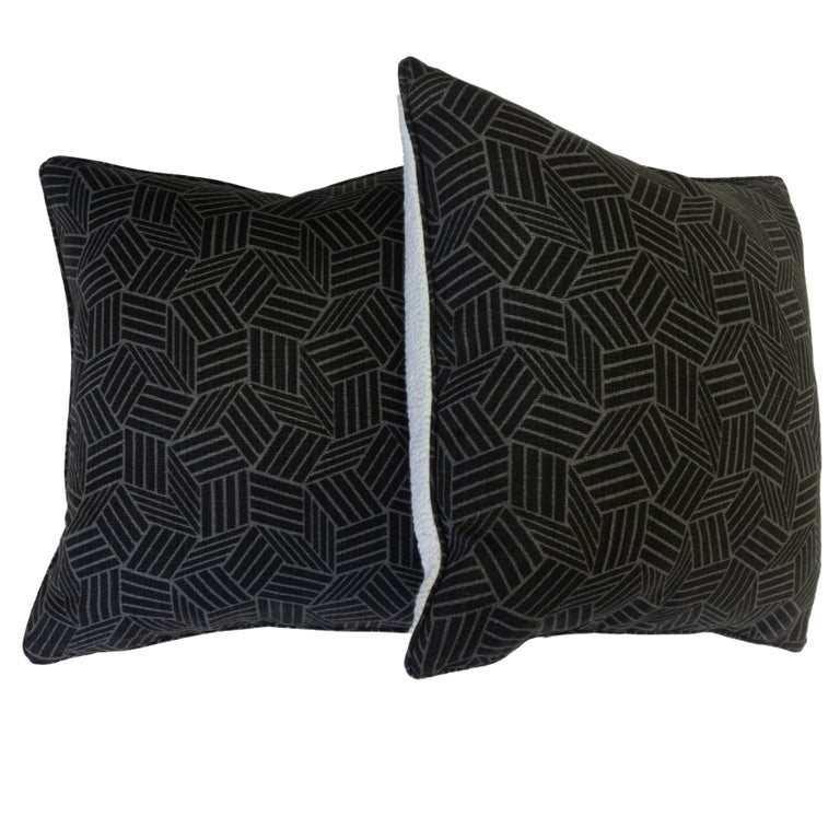 Hand sewn at our Westport showroom, these pillows feature a unique geometric pattern. The pattern is series of vertical and horizontal stripes that add dimensionality. Depending on how you look at it, you can see cubes and stars. The back is sewn in