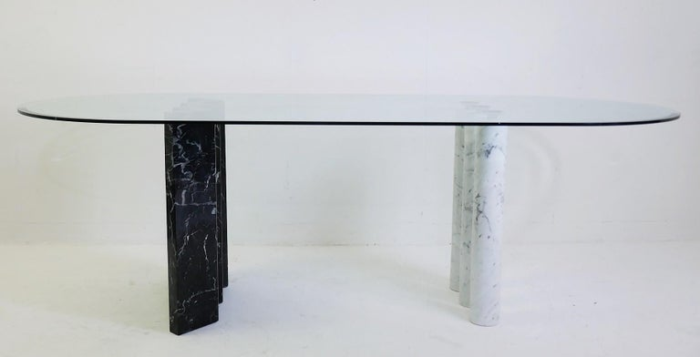 Black and white marble and glass top dining tables.