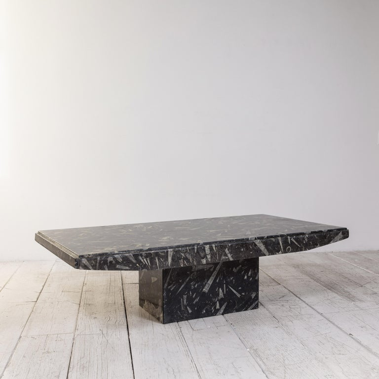 Black and white modernist marble cocktail table adds a modern clean touch to any space.