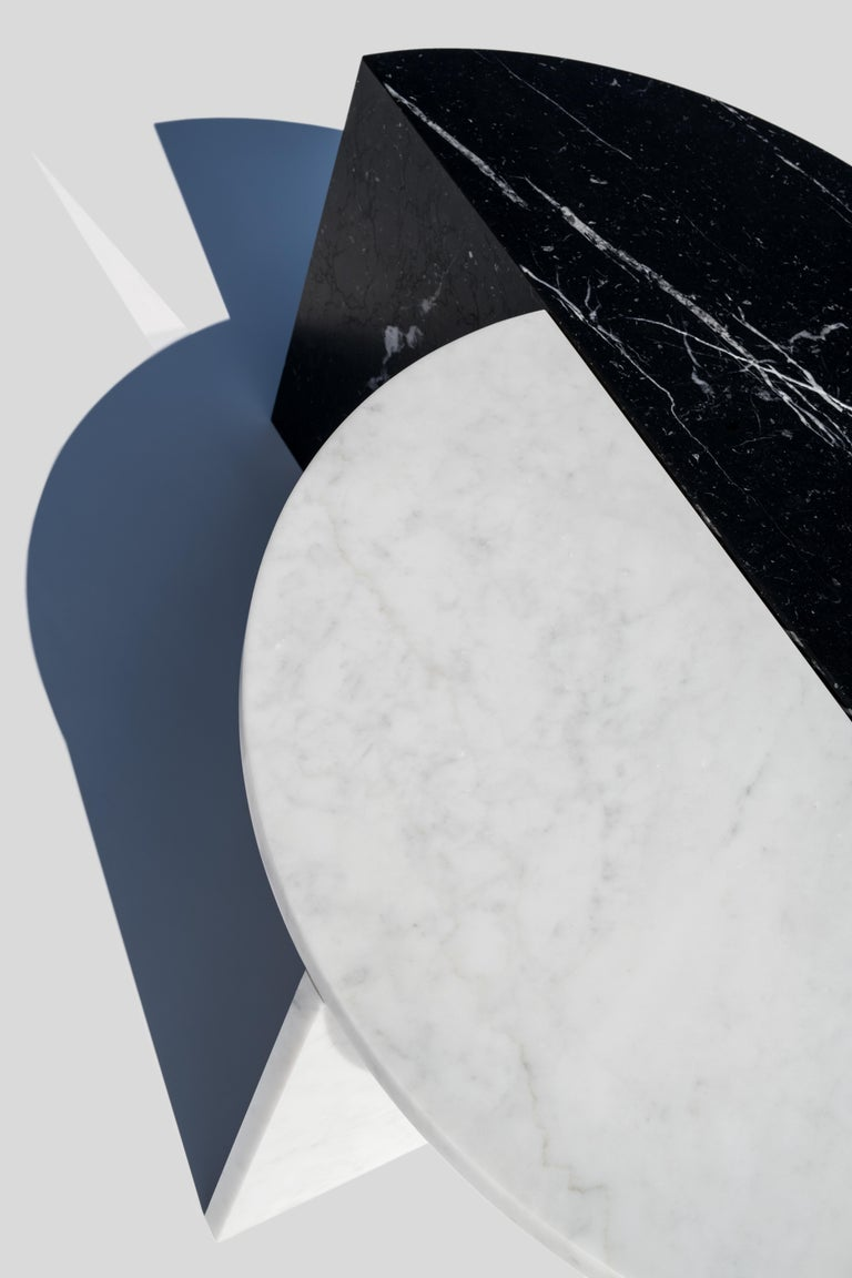 Materials: Marble; Marble: Nero Marquina (black); Carrara (white) Dimensions: 70 x 35 x 35 Designer: Sebastian Scherer  These coffee tables can be combined in a variety of ways creating an interesting mix of form and material. The tables are