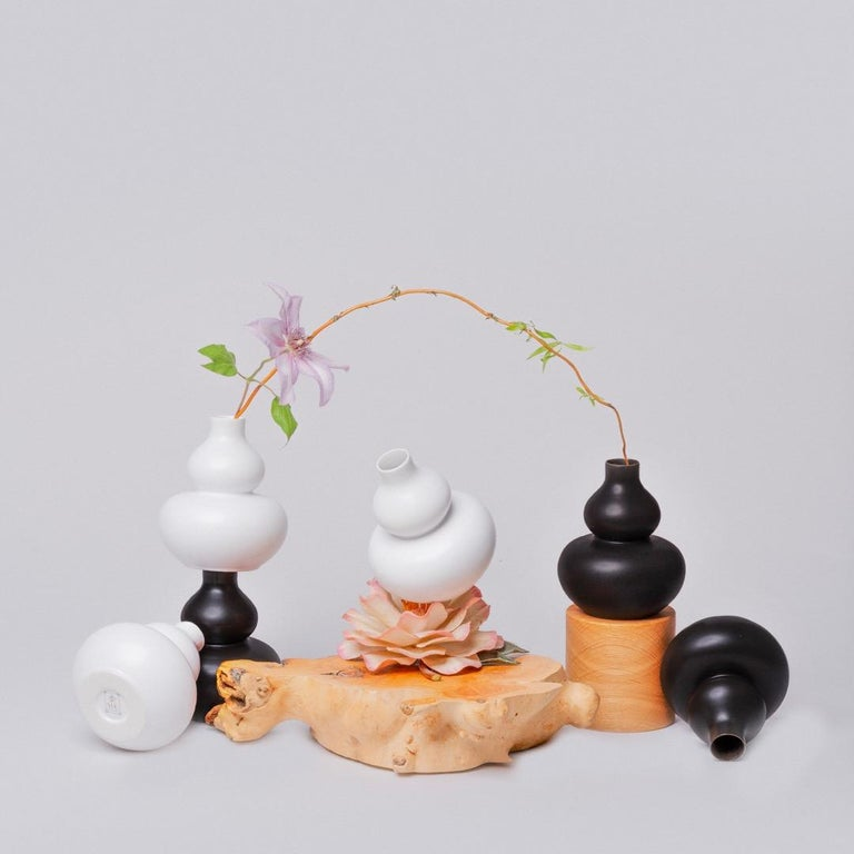 Middle Kingdom miniature porcelain vases are the perfect accent for any space. This broad collection interpreted in black and white creates a sculptural presence, yet can also contain a garden's worth of flowers. Let us choose ten pieces in this