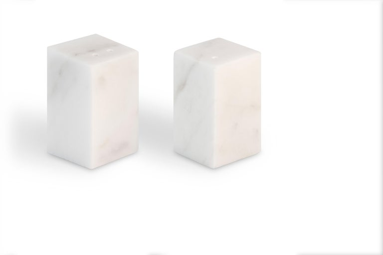Black and white rounded shape salt and pepper set. Each piece is in a way unique (since each marble block is different in veins and shades) and handcrafted in Italy. Slight variations in shape, color and size are to be considered a guarantee of a