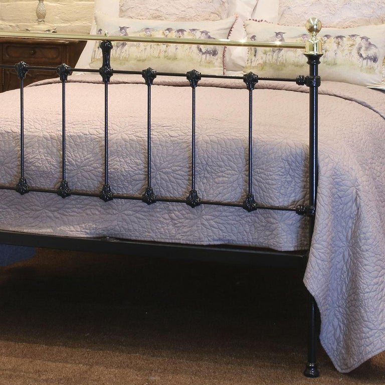 Double Victorian antique bed finished in black with straight top brass rails.  This bed accepts a 4ft 6in wide (54 inch or 135cm) base and mattress.  The price is for the bed frames alone. The bases, mattresses, bedding and bed linen are extra.