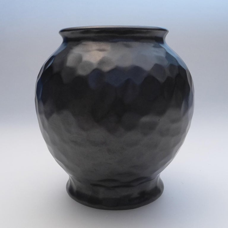 Elegant dimple vase designed by Gerardus Klinkenberg and produced at the Katwijk factory in the Netherlands, circa 1920s Materials: Ceramic stoneware with a smooth black matte glaze.