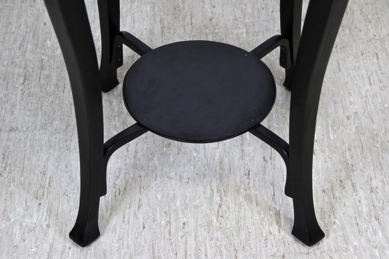 Impressive black Art Nouveau coffee or side table made by the world renown bentwood specialists Jacob & Josef Kohn in Vienna/ Austria, circa 1910. A stunning shape with round tabletop and beautifully curved legs, all artfully connected by an