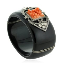 Black Bakelite Cuff with Carved Coral Motif and Diamonds