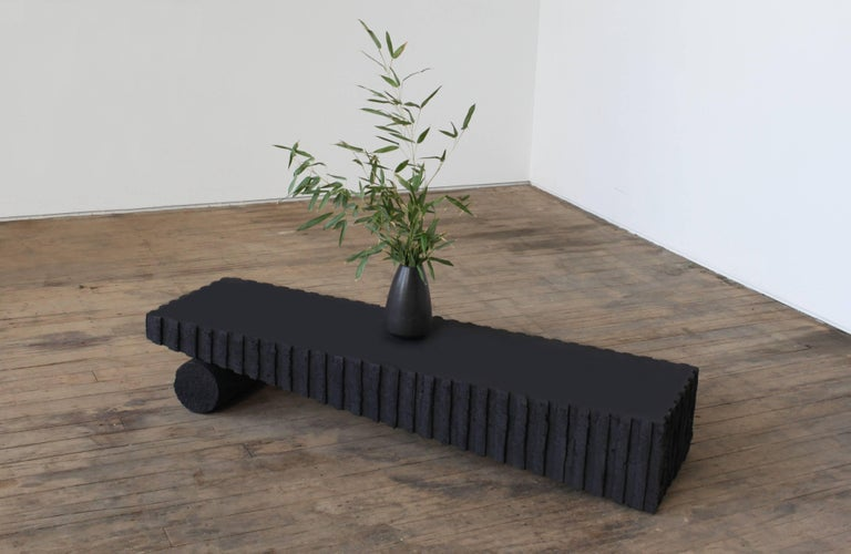 Low table made in cast in a charcoal and concrete composite designed for sight unseen offsite.
