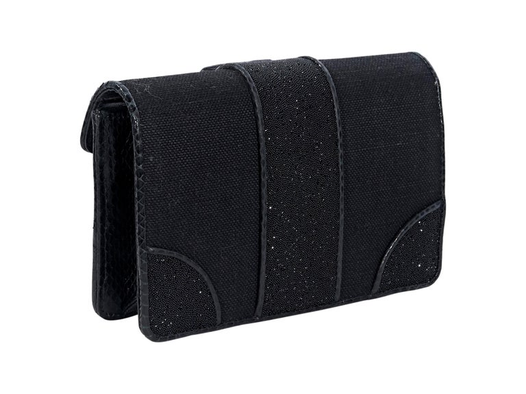 Product details:  Black patterned snakeskin-trimmed crystal-embellished canvas clutch by Bottega Veneta.  Trimmed with snake skin-embossed leather.  Front flap with magnetic closure.  Suede lined interior. Pair yours with a leather mini dress. 7.5
