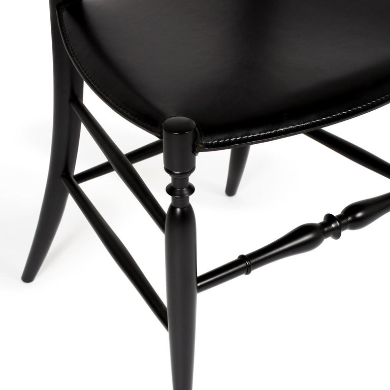 Boasting an extra-tall ladder-back silhouette, this unique chair is an outstanding addition to any interior. Where it will bring an original and distinctive style. Constructed of beechwood with a black-lacquered finish, this chair pays tribute to
