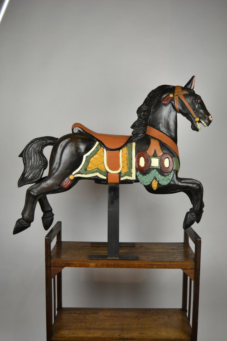 Wooden Carousel Horse - Fairground horse - Merry-go-round Horse. Smaller model, so easy to be placed. This Mid-20th century hand carved Animal Sculpture is a Black horse - Black Beauty mounted on a metal base. It's hand painted with colored