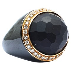 Black Ceramic Ring with a Git Center Stone and 0.90 Carat White Diamonds