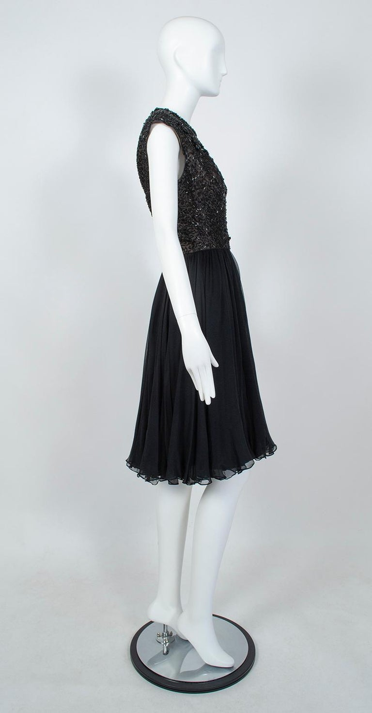 Made for a party, this glamorous dance dress combines the late 50s and early 60s so perfectly that we would bet it was worn on New Year's Eve at the cusp of the new decade. Not quite sleeveless, it incorporates the 50s' penchant for barely-covered