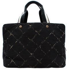 Black Chanel large tote duffle bag with white cross pattern