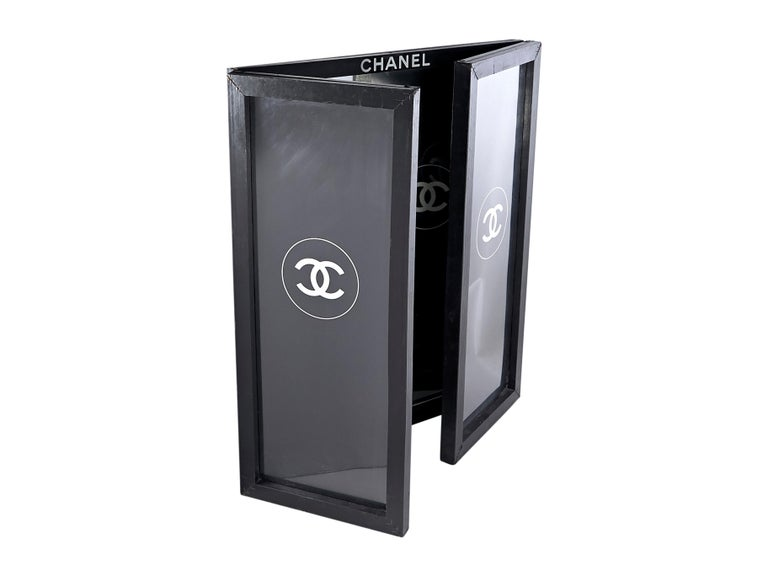 Product details: Black CC logo-accented bifold mirror by Chanel.  Contrast trim. Freshen your red lip in the reflective surface. Side Panels: 9
