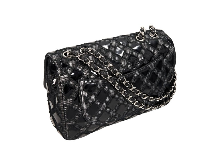 Product details:  Black patent leather and mesh flap shoulder bag by Chanel.  Dual chain shoulder straps.  Front flap with twist-lock closure.  Lined interior with inner zip pocket.  Back exterior slide pocket.  Silvertone hardware.  Authenticity