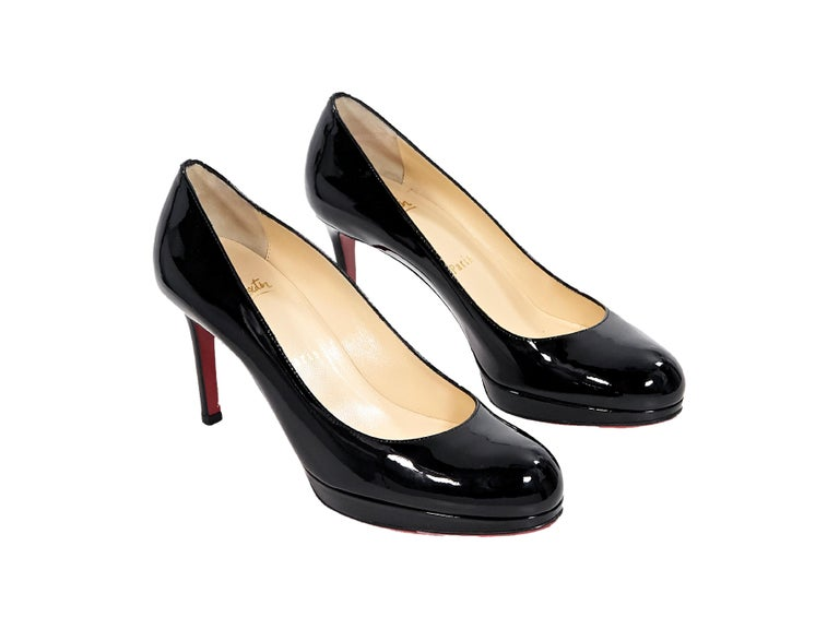 Product details  Black patent leather platform pumps by Christian Louboutin.  Round toe. Iconic 55a7c49cc352