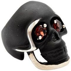 Black Coated Sterling Silver Skull Ring with Garnet Eyes