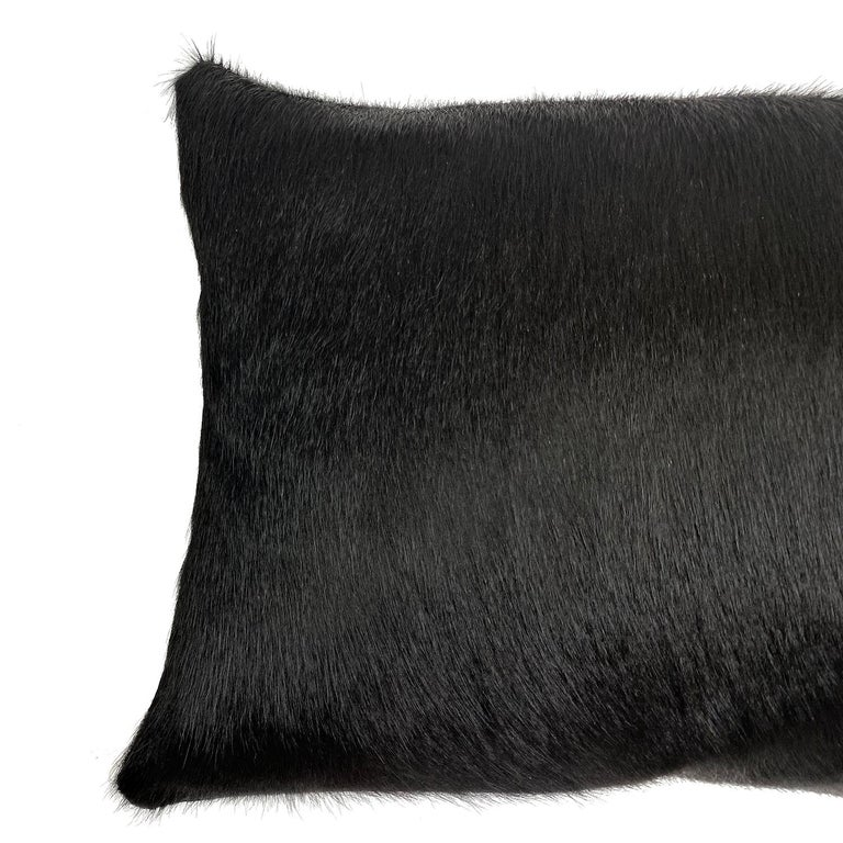 Create an atmosphere of stylish design with this striking black cowhide pillow. Whether layering with other textures and cushions or styled on its own this lustrous black cowhide cushion will transform rooms in an instant.