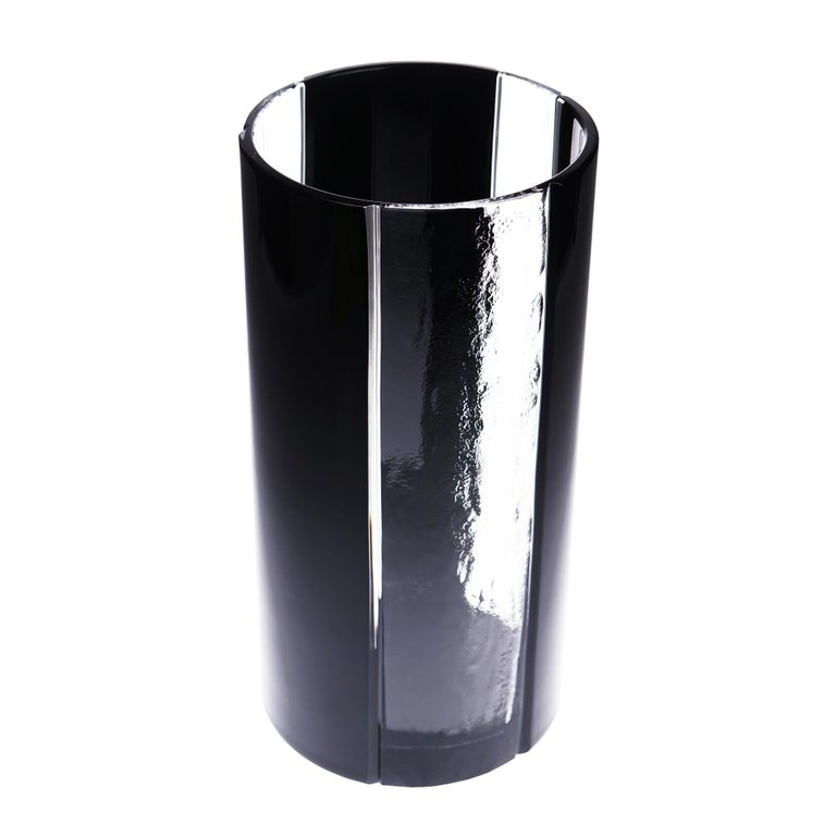 Black crystal vase  The latest creation of Cristallerie de Montbronn, this vase tube is at the top of modernity.  Name : Kem.  3 clear crystal strips (different sizes) obtained by a technique unique in the world that only Cristallerie de